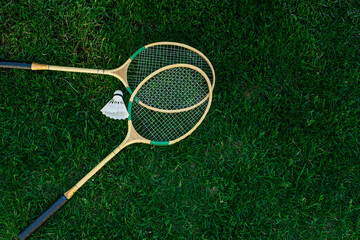Badminton rackets and shuttlecocks isolated on green, top view, Fresh lawn