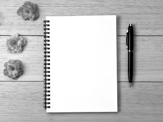 spiral notebook and pen on desk background