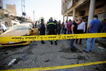 Police tape cordon is seen at the site of a car bomb attack near a government office in Karkh district in Baghdad