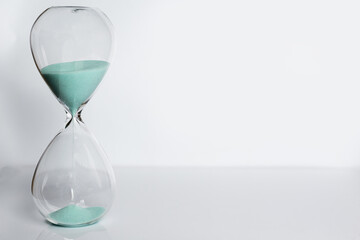 Old hourglass on white background.