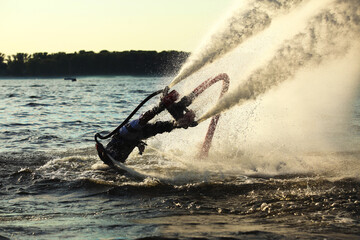 Man flying over water on flyboard