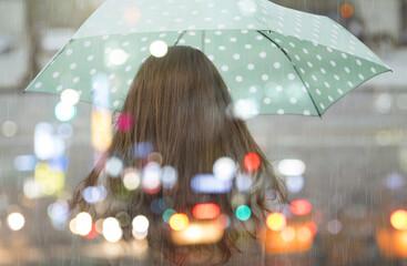 Alone girl in Paris, rainy day