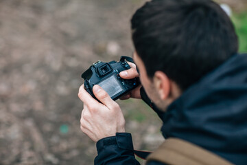 A professional photographer adjusts the camera
