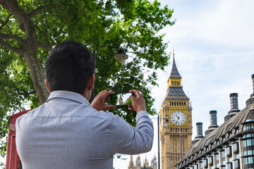 LONDON, UK - May 22, 2017: Big Ben and Portcullis House, Westminster. Portcullis House is where the offices of Members of Parliament and there staff are.