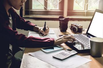 Man's work on my desk light sunset business concept Vintage tone.