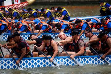 Participants take part in a dragon boat race to celebrate Dragon Boat festival in Nantong, Jiangsu