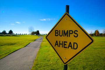 Bumps Ahead Sign Near Paved Path