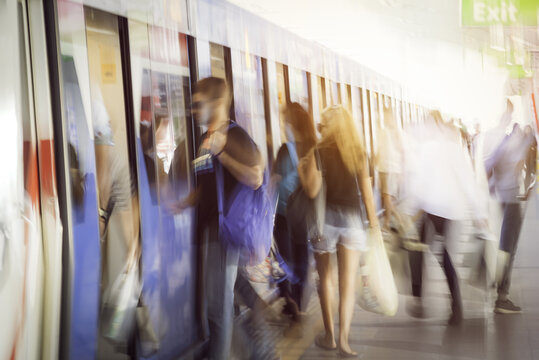 Blurred people getting in railroad station urban systems in most cities for background