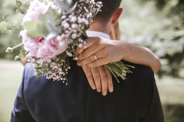 brides hands while hugging