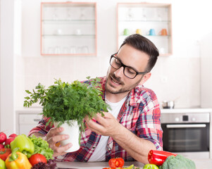 Man holding pot with herbs for vegetable meal