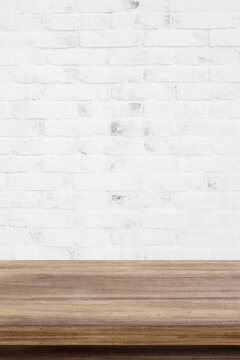 Empty wooden table over white brick wall  background, for product display montage