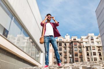 Trendy man posing in sunglasses