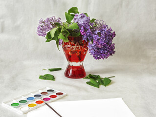Red vase with lilac flowers and watercolors