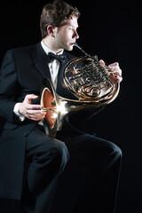 Poster Muziek French horn player. Classical musician playing horn