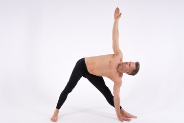 Yoga. Sexy man and a healthy lifestyle. Sport and strength.
