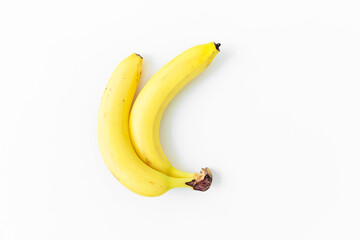 Banana on white background. Flat lay. Top view. Summer concept