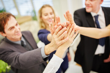 Hands of business people giving a high five