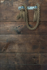 vintage wooden crate side with old rope handle