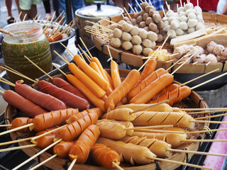 skewers meatballs and sausages on bamboo sticks, thailand traditional street food