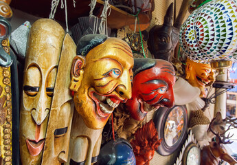 Store with vintage theatrical masks, art objects and antiques in second-hand department