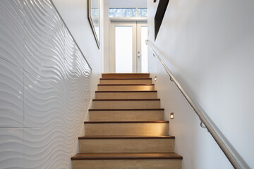 Staircase with wooden steps and interior details