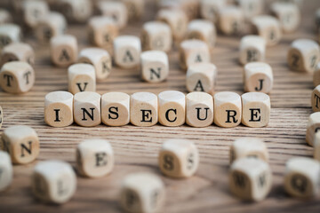 "ubes with word ""insecure"" surrounded by many other cubes"