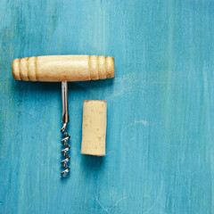 Photo of wine corkscrew and cork on vibrant background
