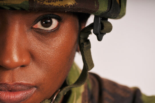Half face portrait of female soldier suffering with PTSD.