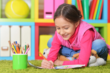 Cute little girl drawing picture