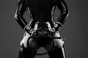 Sensual woman in black latex costume
