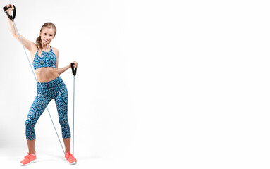 Woman performs fitness exercises on white background.