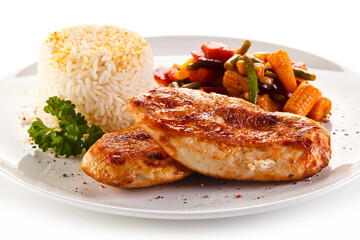 Roast chicken filet with rice and vegetables on white background
