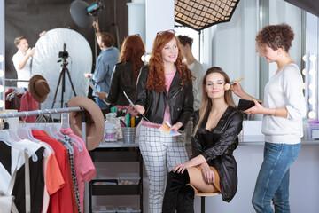 Make-up artist preparing model