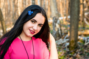 Portrait of a lovely young girl in a spring forest against a background of snowdrops, Scílla, Galánthus