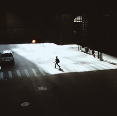 High Angle View Of Silhouette Woman Crossing Road
