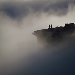 Two People Standing In Cliff