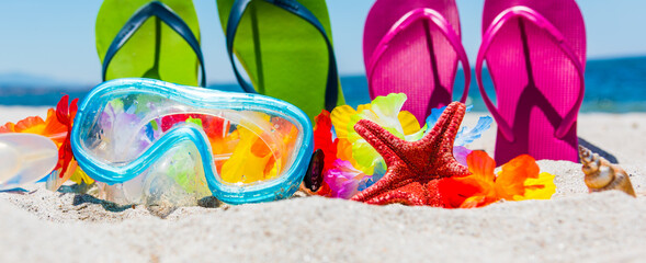 Scuba mask and colorful flip flops