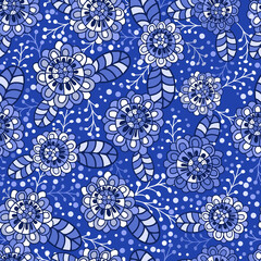 Seamless texture. Multicolor pattern ofleaves flowers and twigs. Shades of blue