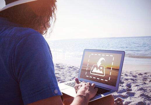 Laptop User on Beach Mockup
