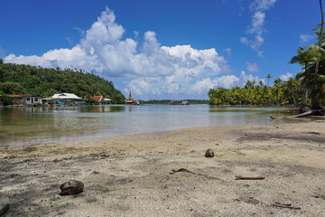 Shore on a natural channel between the ocean and the lake Fauna Nui near the small village of Maeva, French Polynesia, Huahine island, south Pacific