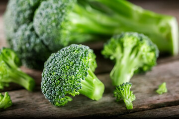 Pieces of broccoli, rustic style, old wooden background