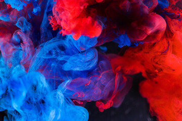 Abstract background, smoke texture in the air. Smoke fragments isolated on dark background.