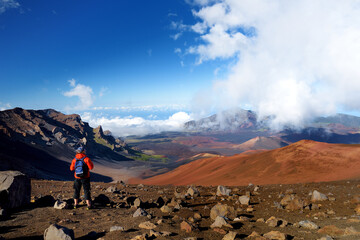 Tourist hiking in Haleakala volcano crater on the Sliding Sands trail.