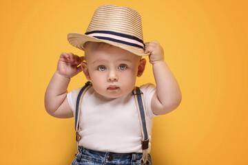 Adorable little baby boy posing.