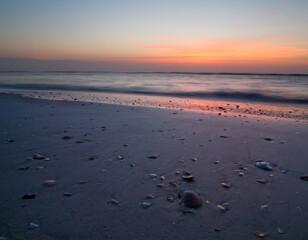 Peacful sunrise on florida beach with shells, near St Augustine