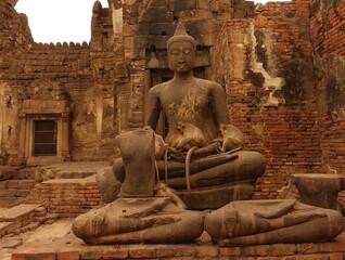 Sleeping Monkeys on a Buddha