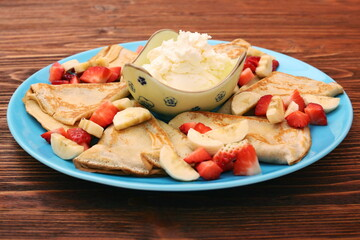 Delicious pancake with sliced of strawberry and banana