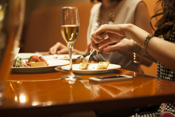 Women are eating dinner at a restaurant