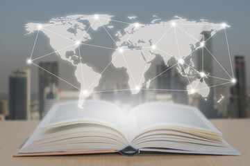 Open book on the wood and world map over the book with connection digital network with blured city background.