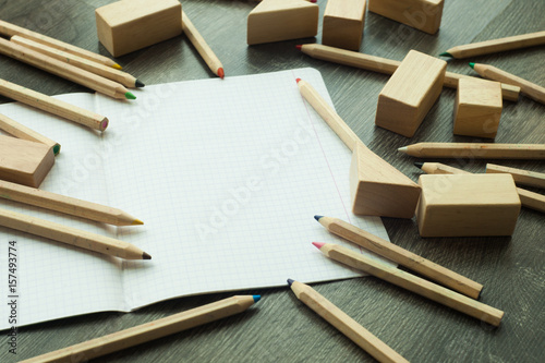 Workspace With Colored Pencils And Notebook On Wooden Table Small